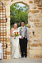 USA, Texas, Bride and groom with bridal bouquet, smiling - ABAF000269