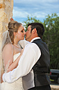 USA, Texas, Bride and groom romancing, close up - ABAF000250