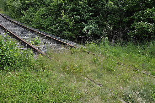 Germany, Bavaria, View of rail track ends in meadow - AXF000251