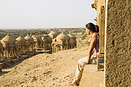 India, Rajasthan, Jaisalmer, Tourist at Bada Bagh Cenotaphs - MBEF000487