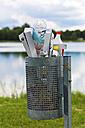 Austria, Upper Austria, Linz, Waste in basket at Lake Pichling - EJWF000145