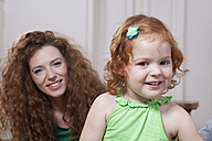 Germany, Berlin, Mother and daughter having fun at home - RBF001006