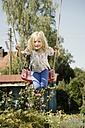 Germany, Bavaria, Girl swinging on swing - RNF001036