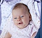 Germany, Bavaria, Baby girl in crib, smiling - HSIYF000017