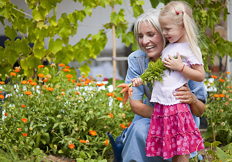 Germany, Bavaria, Mature woman with girl in garden - HSIYF000024