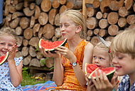 Germany, Bavaria, Group of children eating watermelon - HSIYF000056