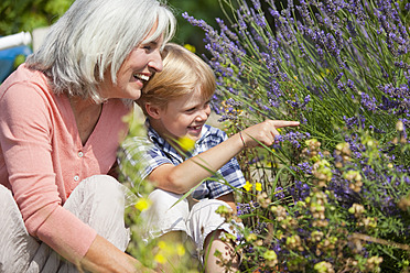 Germany, Bavaria, Mature woman with boy in garden - HSIYF000086