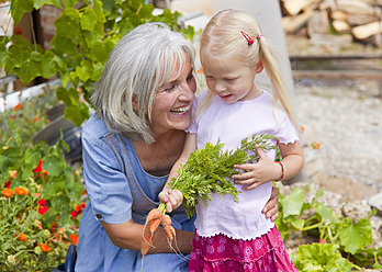 Germany, Bavaria, Mature woman with girl in garden - HSIYF000129