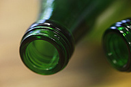 Germany, Close up of green bottles - JTF000041