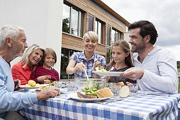 Germany, Bavaria, Nuremberg, Family having barbecue in garden - RBYF000220