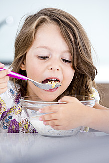 Germany, Girl eating muesli in kitchen - RFF000026