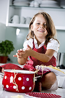 Germany, Girl playing with spaghetti, smiling, portrait - RFF000062