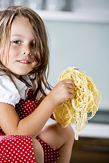 Germany, Girl playing with spaghetti - RFF000065