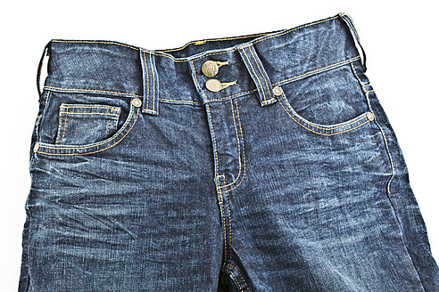 Close up of blue jeans on white background - MAEF005012