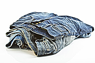 Variety of blue jeans on white background, close up - MAEF005021