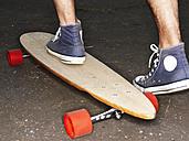 Germany, Duesseldorf, Human foot on skateboard, close up - STKF000029