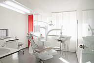 Germany, Dentist chair and equipment in dental office - FMKYF000159