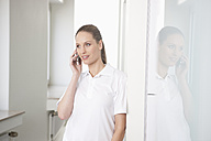Germany, Dentist talking on phone - FMKYF000171