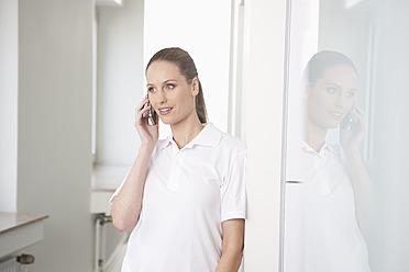 Germany, Dentist talking on phone - FMKYF000171