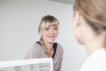 Germany, Women smiling in dental office - FMKYF000195