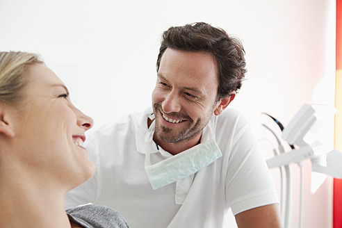 Germany, Dentist and patient in clinic, smiling - FMKYF000204