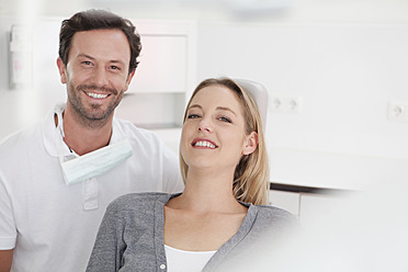 Germany, Dentist and patient in clinic, smiling - FMKYF000207