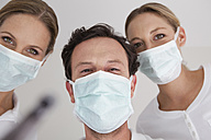 Germany, Dentist with surgical mask, portrait - FMKYF000219