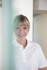 Germany, Dentist smiling, portrait - FMKYF000222