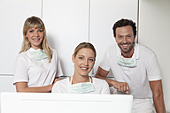 Germany, Dentist smiling, portrait - FMKYF000246