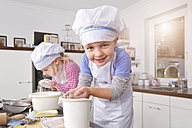 Germany, Girl and boy making dough in kitchen - FKF000082
