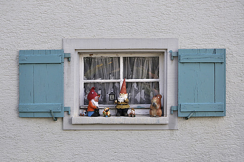 Germany, Baden Wuerttemberg, Window with shutter and garden gnomes - AXF000296