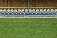 Germany, Bavaria, Munich, Stand with blue and yellow plastic seats - AXF000329