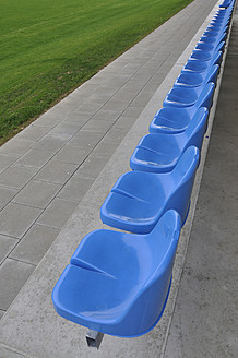 Germany, Bavaria, Munich, Stand with blue plastic seats - AXF000332