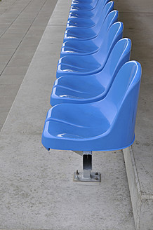 Germany, Bavaria, Munich, Stand with blue plastic seats - AXF000334