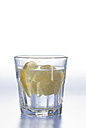 Glass of water with lemon slice on white background - ASF004644
