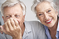 Spain, Senior couple smiling, close up - PDYF000159