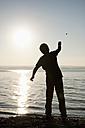 Germany, Bavaria, Boy playing on shore at Lake Ammersee - UMF000520