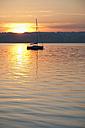 Germany, Bavaria, Sailing boat on Lake Ammersee at sunset - UMF000518