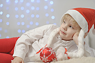 Boy holding christmas bauble - MJF000149
