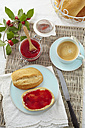 Cornel cherry jam with bread rolls and coffee on table - ECF000108
