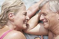 Spain, Mallorca, Happy senior couple at beach - PDYF000266
