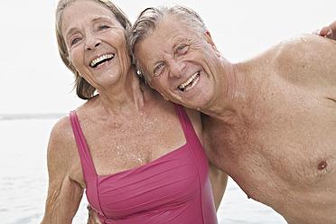 Spain, Senior couple on beach - PDYF000251