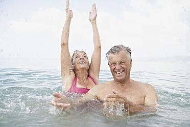 Spain, Senior couple swimming in sea - PDYF000236