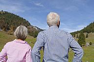 Germany, Bavaria, Senior couple on mountain hike near Wendelstein - TCF002990