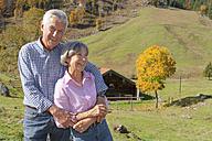 Germany, Bavaria, Senior couple on mountain hike near Wendelstein - TCF002993