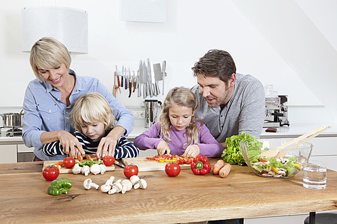 Germany, Bavaria, Munich, Family preparing food in kitchen - RBYF000292