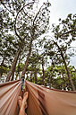Portugal, Young man lying in hammock at pine forest - WVF000292