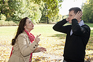 Germany, Berlin, Couple arguing in autumn park - BFRF000122