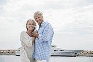 Spain, Senior couple at harbour, smiling, portrait - WESTF019044