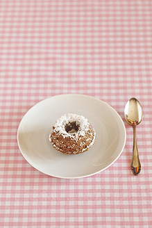 Miniature cakes with powdered sugar and spoon on plate - JTF000205